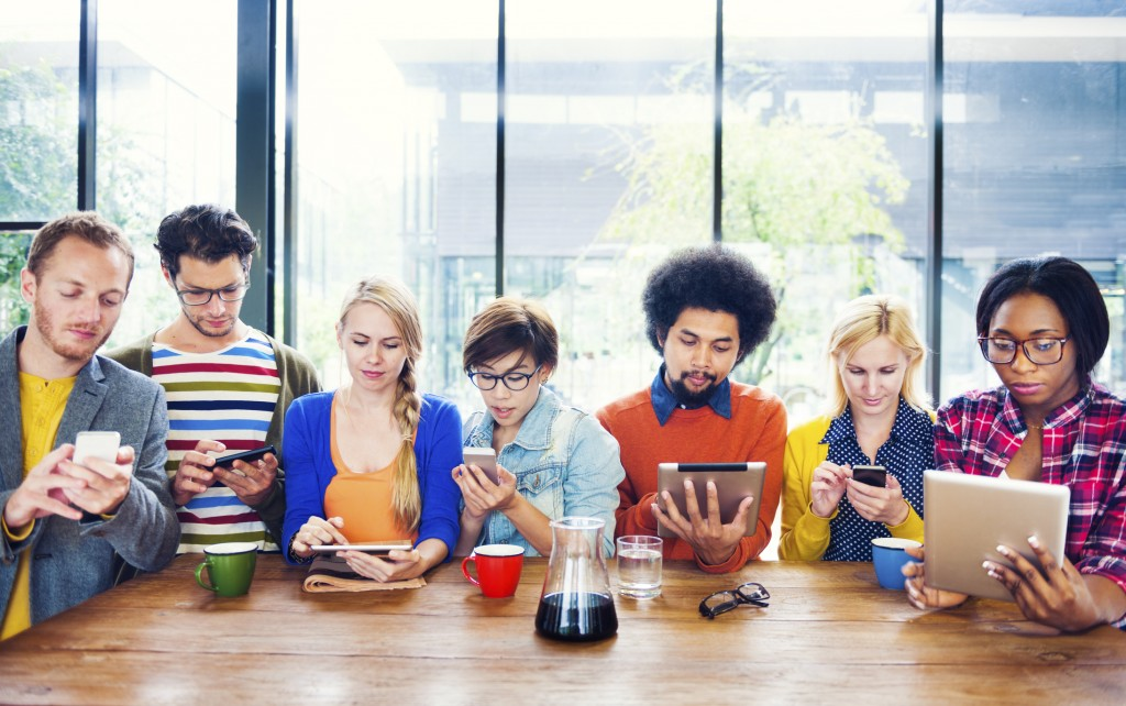 Multiethnic Group of People Social Networking at Cafe